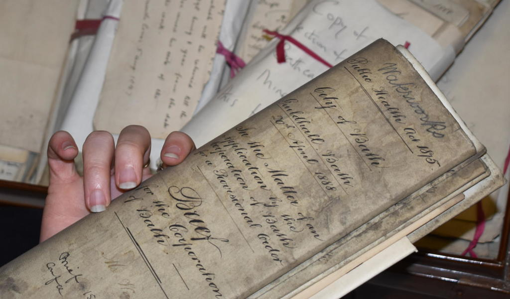 Folded manuscript document held in hand