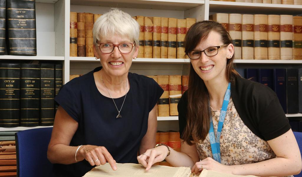 A researcher and a member of staff at the newly-refurbished Bath Record Office