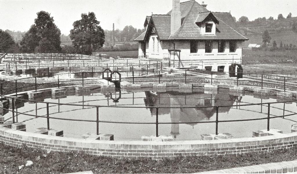 Black and white photograph of sewage tanks