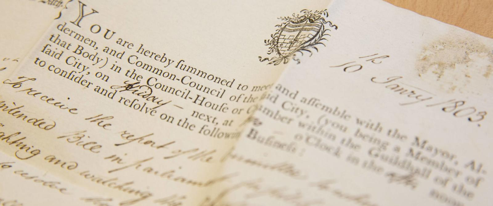 Photograph of part of a letter summoning a councillor to a meeting, 1803