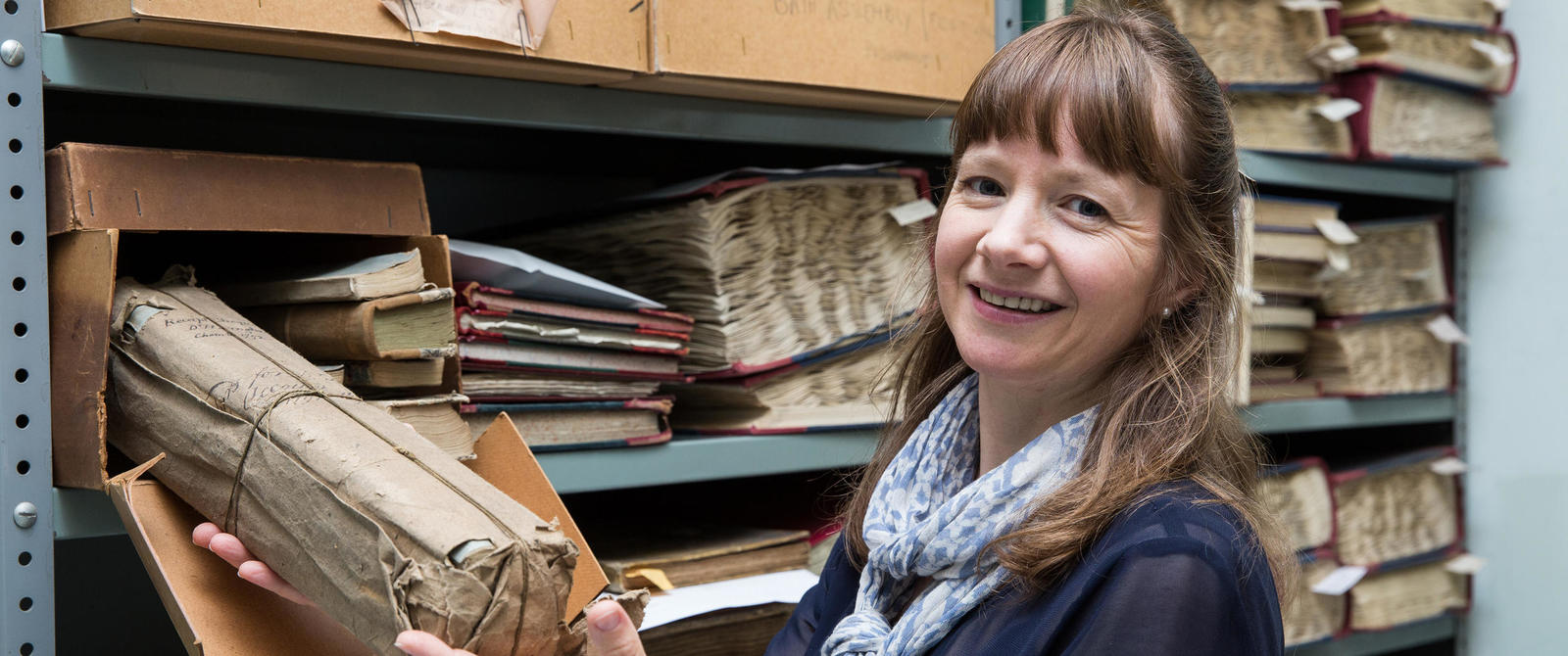 Image: Photograph of an archivist in a strongroom
