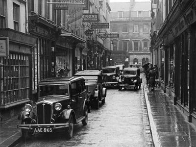 Photograph showing traffic and parked cars in Green Street, Bath, about 1935