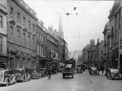 Photograph of High Street, Bath, about 1935 (ref. PX198), showing parked cars and traffic
