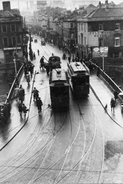 Photograph showing trams on the Old Bridge