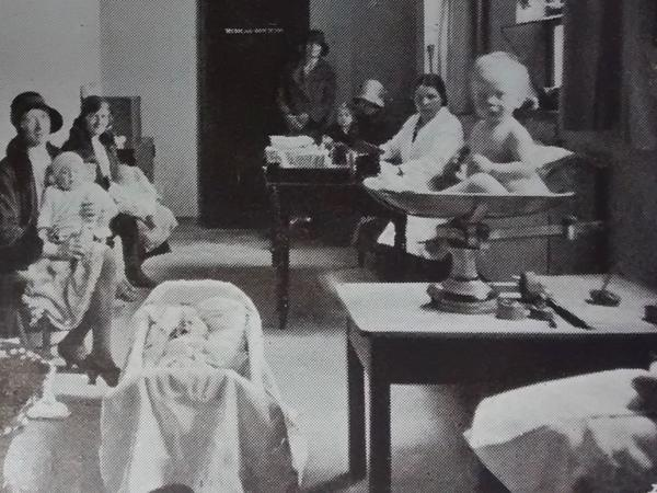 Black and white photograph of baby clinic, 1930s