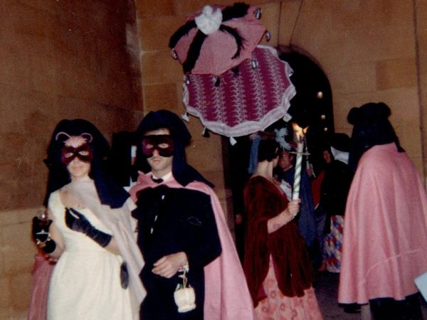 Masked guests walking in the colonnades, Parade Gardens