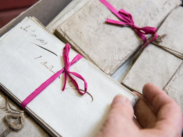 Image: Bundles of papers tied in pink ribbon of Edmund Anderdon, Bath City Councillor from 1787 to 1832