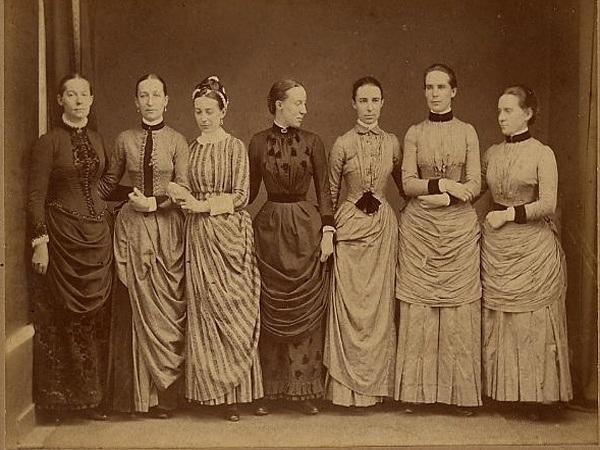 Photograph of seven young women in late Victorian dress