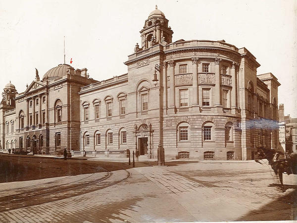 Sepia image of the south wing of Bath Guildhall 1899