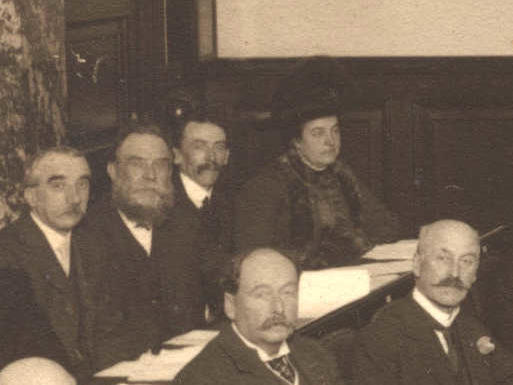 1911 photograph of Councillor Helen Hope in the Council Chamber among other councillors