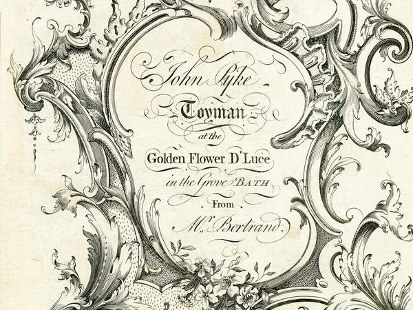 Part of an old ornate black and white trade card