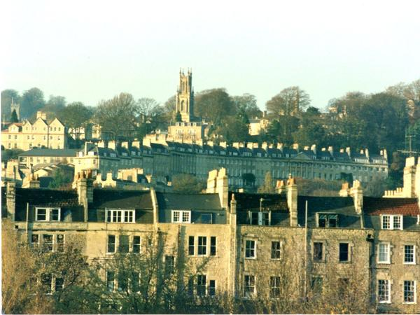 Sunlit view of Bath looking over rooftops to St Stephens Chuch