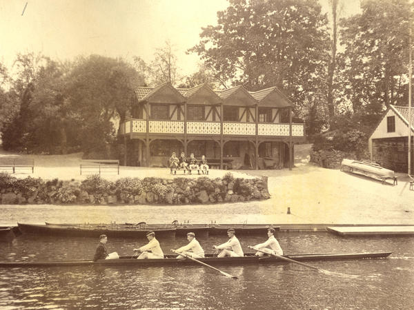 Sepia image of a rowing four on the river with the Bath boating station in the background